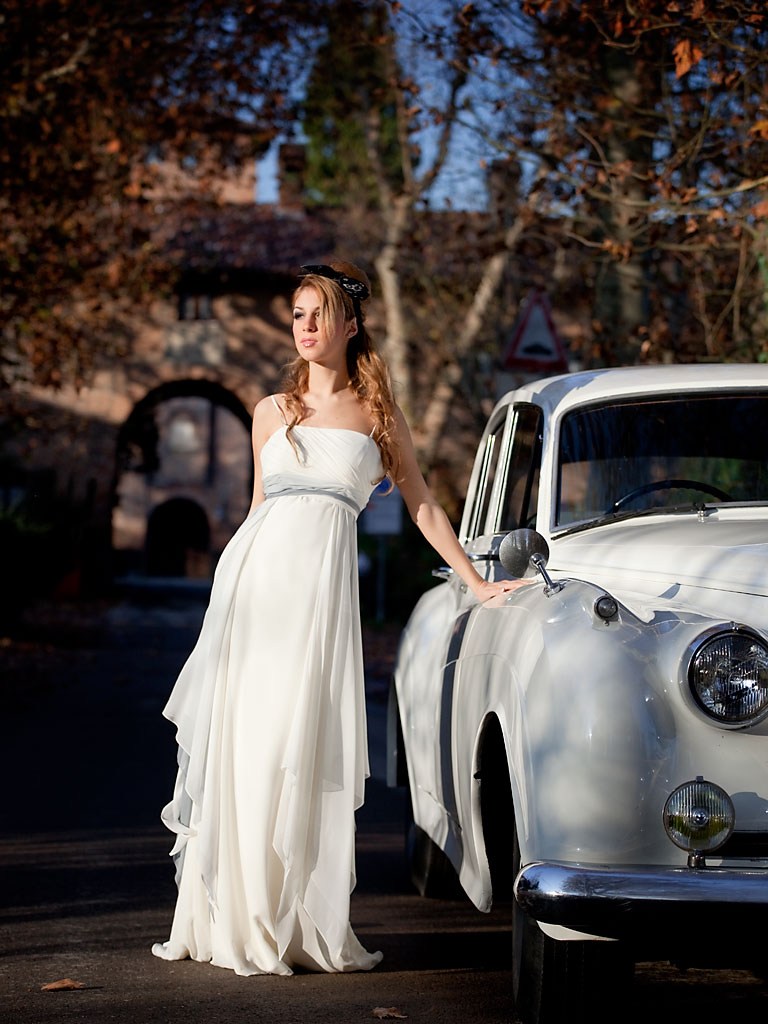 Fashion bridal gowns and vintage car